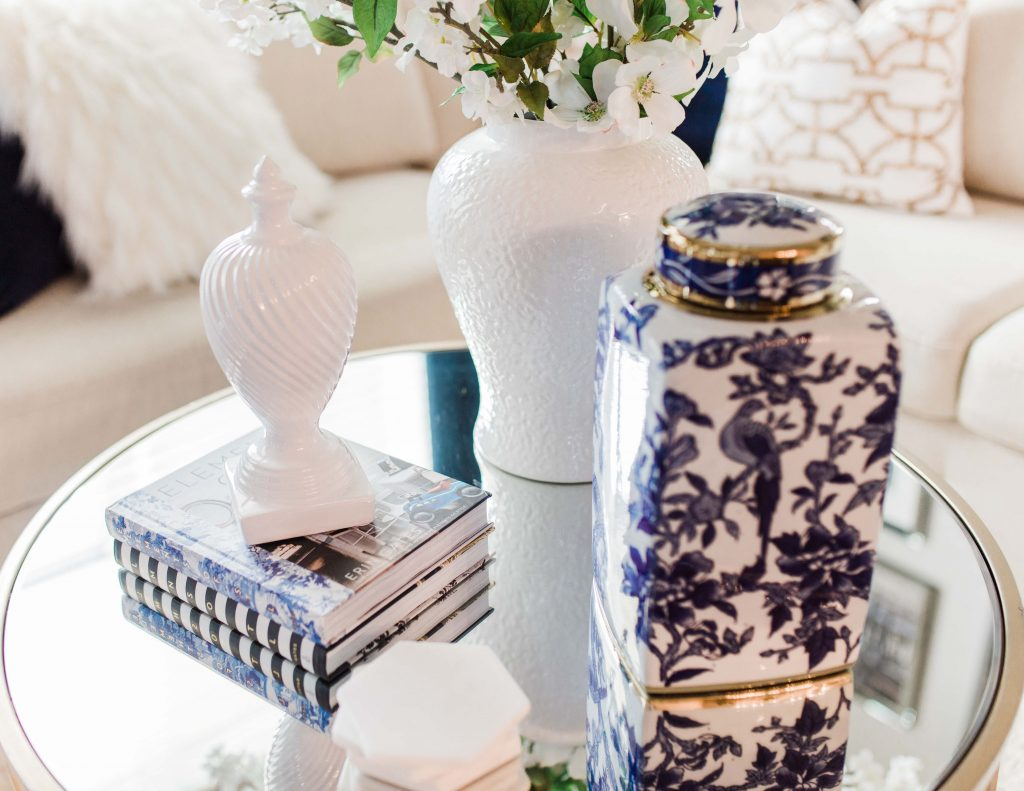 5 ways to bring spring into your home this year. Let's start with this glam gold ginger jar!  Let me show you how to style your coffee table and living room this spring! https://lisaherlanddesigns.com